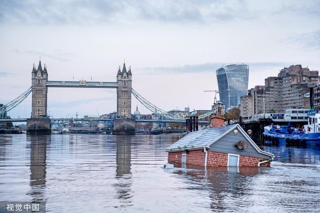每日壹图:英国|房子浸入泰晤士河 环保组织呼吁公众关注全球变暖