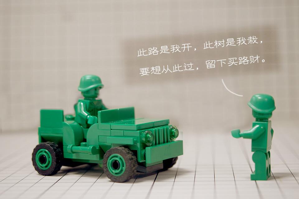 """""""霸王村""""以巨石设卡背后:应回应超载卡车对水泥村路的损坏问题"""
